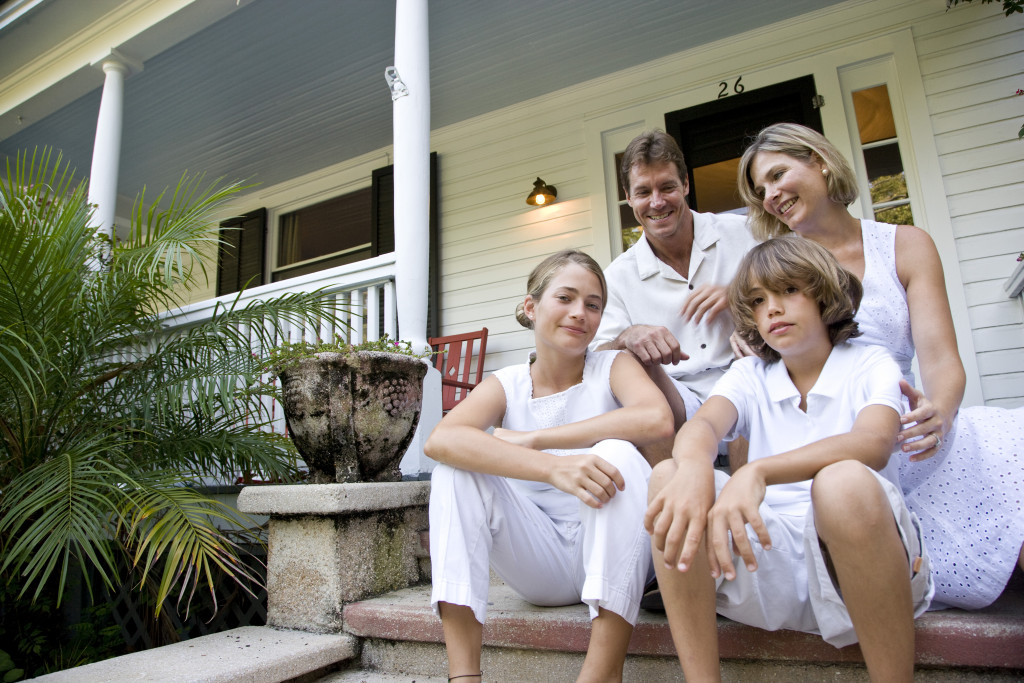 family sitting by the porch